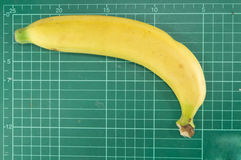 Banana on cutting mat. On white background Stock Photography