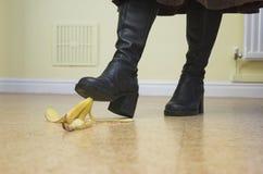 Banana Danger!. Banana skin lies ready to cause a painful slip-up. Slapstick concept illustrating danger and pitfalls Stock Photography