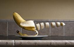 Banana de flutuação Foto de Stock Royalty Free