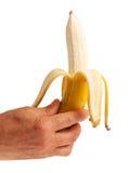 Banana descascada na mão humana Imagens de Stock