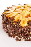 Banana dessert cake with dark chocolate topping Royalty Free Stock Photography