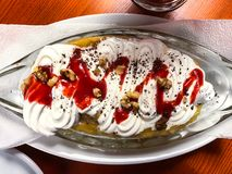 Banana dessert with whipped cream. Studio Photo royalty free stock images