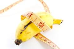 Banana di dieta su priorità bassa bianca Immagini Stock Libere da Diritti