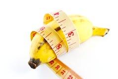 Banana di dieta su priorità bassa bianca Fotografia Stock Libera da Diritti