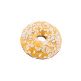 Banana donut in yellow glaze with chips. A single banana yellow glazed donut with wight chocolate chips isolated white background Stock Photos