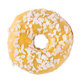 Banana donut in yellow glaze with chips. A single banana yellow glazed donut with wight chocolate chips  white background Stock Images
