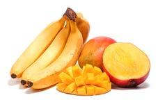 Banana e mango con la metà affettata Fotografie Stock Libere da Diritti