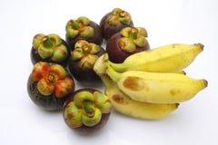 Banana e mangustão Fotografia de Stock