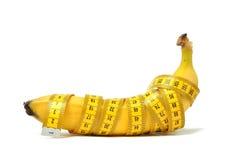Banana e nastro di misura Immagine Stock