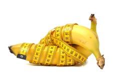 Banana e nastro di misura Immagini Stock Libere da Diritti