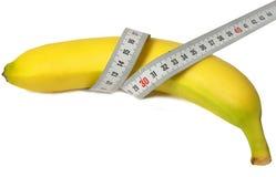 Banana e righello Fotografie Stock Libere da Diritti
