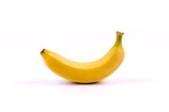 Banana em um fundo branco Imagem de Stock