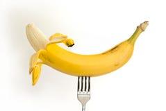 Banana em uma forquilha do metal Imagem de Stock Royalty Free