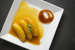 Banana flambee with caramel fusion asian dessert. Banana flambee with caramel fusion modern asian dessert Stock Images