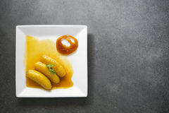 Banana flambee popular dessert on simple modern background Royalty Free Stock Images
