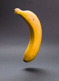 A banana floating in the air in vertical composition Royalty Free Stock Photos