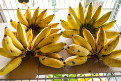 Banana. Four banana in shelf for sale to people royalty free stock images