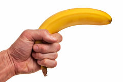 Banana fruit gun hold in hand. Royalty Free Stock Photos