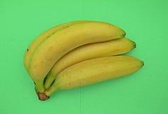 Banana fruits over green background Stock Photos