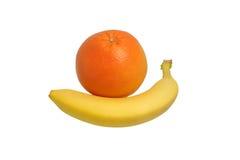 Banana and grapefruit. Close-up Stock Photo