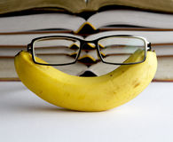 Banana great for brains. A pair of glasses on a banana royalty free stock images