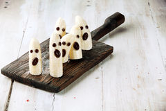 Banana Halloween Ghosts with Chocolate Faces. On Wooden Cutting Board Royalty Free Stock Photos