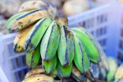 Banana hanging in asian market Royalty Free Stock Images
