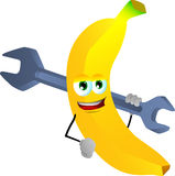 Banana holding a huge wrench Royalty Free Stock Images