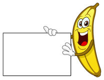 Banana holding a sign Royalty Free Stock Image