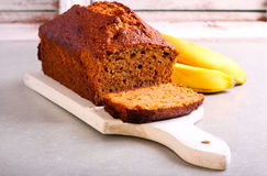 Banana and honey loaf cake on board Stock Images