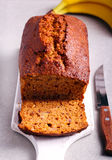 Banana and honey loaf cake on board Royalty Free Stock Image