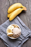 Banana ice cream in bowl. Banana ice cream  and fresh fruits, country style, top view Stock Photo