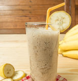 Banana juice. On a wooden table stock photography