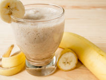 Banana juice. On a wooden table royalty free stock image