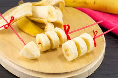 Banana kebab decoration served on wooden tray Stock Photos