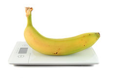 Banana on kitchen scale Royalty Free Stock Photos
