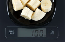 Banana on kitchen scale Stock Photography