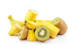 Banana and kiwi massacre. Pile of sliced banana and kiwi stock photo