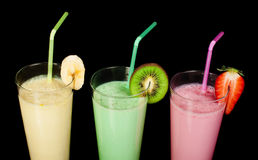 Banana, kiwi and strawberry milk shake and fresh fruis Stock Images