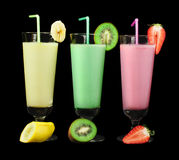 Banana, kiwi and strawberry milk shake and fresh fruis Stock Photography