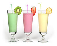 Banana, kiwi and strawberry milk shake and fresh fruis royalty free stock photos