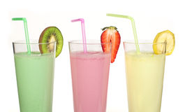 Banana, kiwi and strawberry milk shake and fresh fruis Royalty Free Stock Images