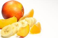 Banana, laranja e pêssego Imagens de Stock Royalty Free