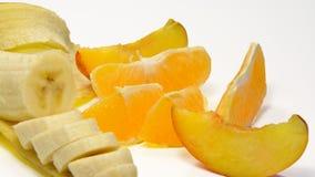 Banana, laranja e pêssego Fotografia de Stock