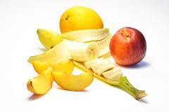 Banana, laranja e pêssego Imagens de Stock