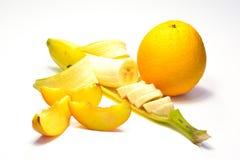 Banana, laranja e pêssego Fotos de Stock
