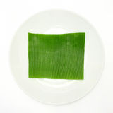 Banana leaf on blank plate Stock Photo