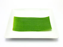 Banana leaf on blank plate Royalty Free Stock Photos