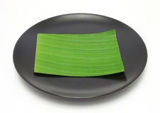 Banana leaf on blank plate Stock Photography