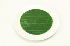 Banana leaf on blank plate for edit food. Or subject on Royalty Free Stock Photos